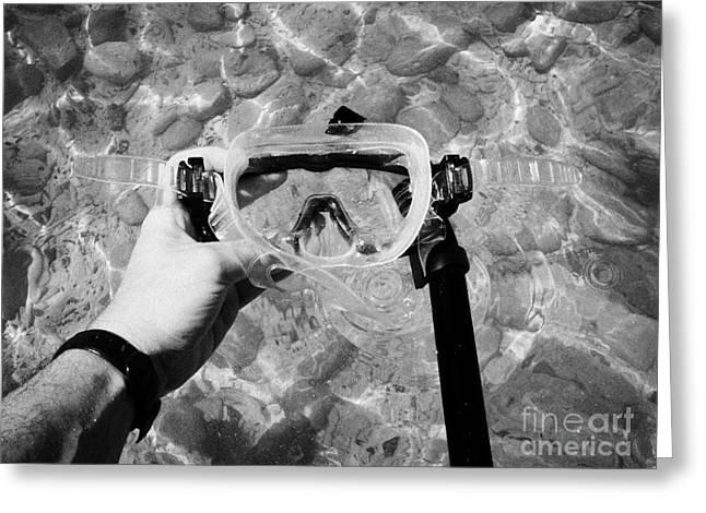 Man Washing Snorkel Facemask In Seawater Florida Keys Usa Greeting Card by Joe Fox