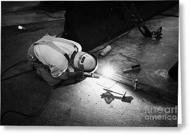 man welding metal plates together on the street Las Vegas Nevada USA Greeting Card by Joe Fox