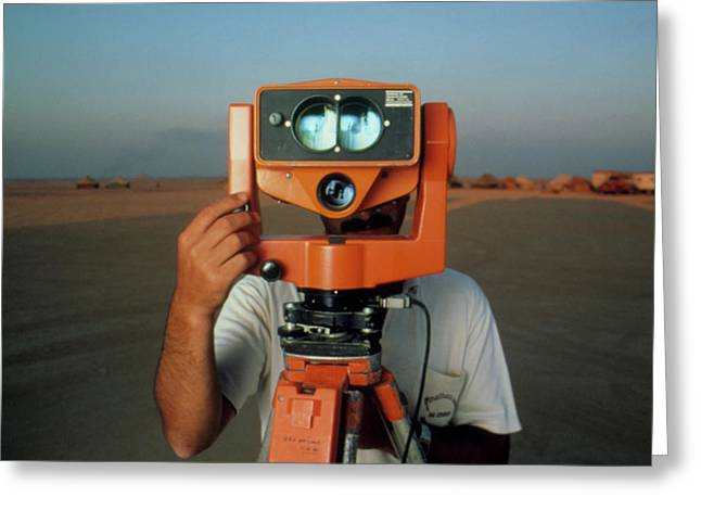 Man With A Survey Instrument In The Libyan Dessert Greeting Card by Joe Pasieka/science Photo Library