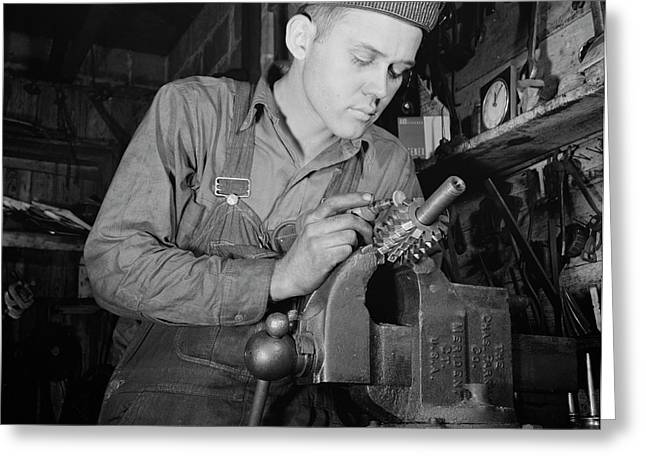 Man Working In A Small Machine Shop Greeting Card by Stocktrek Images