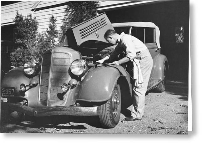Man Working On His Car Greeting Card