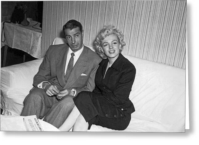 Marilyn Monroe And Joe Dimaggio Greeting Card by Underwood Archives