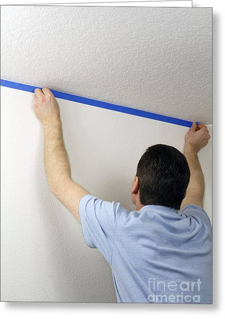 Masking A Wall With Blue Tape Greeting Card