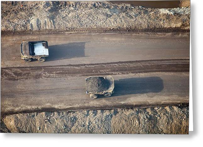 Massive Dump Trucks Loaded With Tar Sand Greeting Card by Ashley Cooper