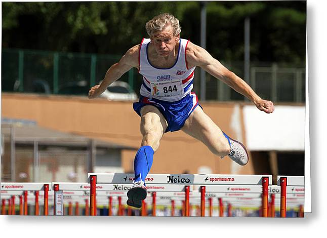 Masters British Athlete Clearing Hurdle Greeting Card by Alex Rotas