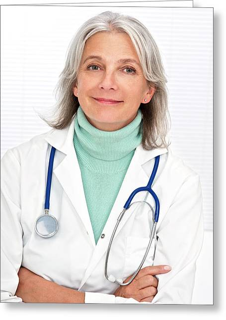 Mature Female Doctor Smiling Greeting Card