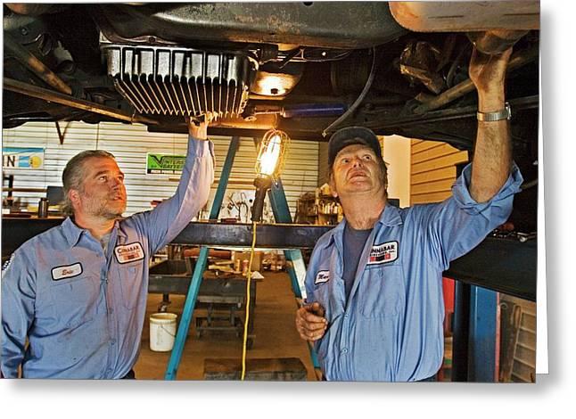 Mechanics Repairing Recreational Vehicle Greeting Card