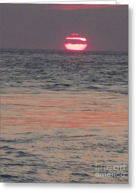 Melting Sun Into The Cool Sea Greeting Card by Eric  Schiabor