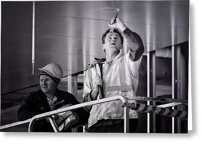 Greeting Card featuring the photograph Men At Work by Wallaroo Images