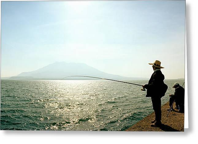 Men Fishing In Sakurajima Island Greeting Card by Panoramic Images