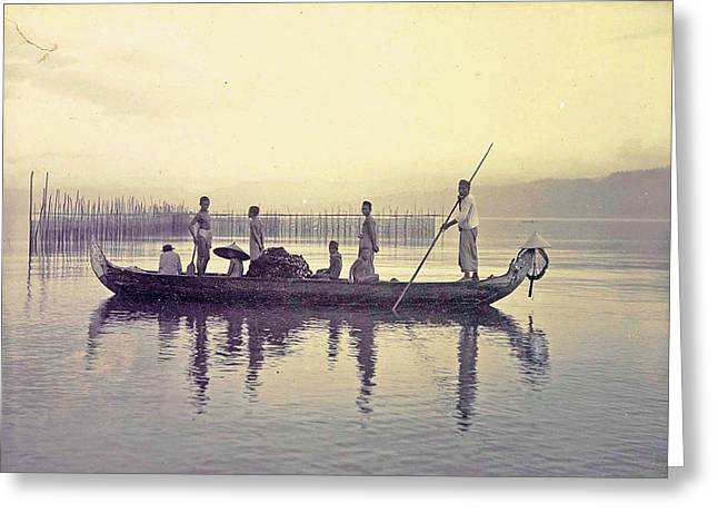 Men In A Canoe In The Bay Of Ambon, Indonesia Greeting Card by Artokoloro