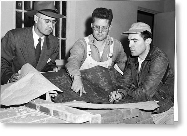 Men Looking At Blueprints Greeting Card by Underwood Archives
