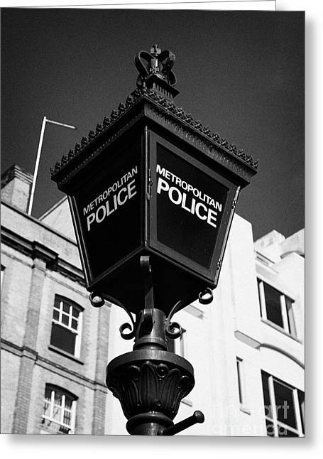 metropolitan police blue lamp sign outside a police station London England UK Greeting Card by Joe Fox