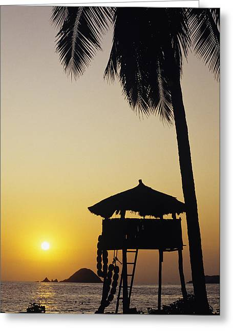 Mexico, Silhouette Of Beach Bungalow Greeting Card by Bill Schildge