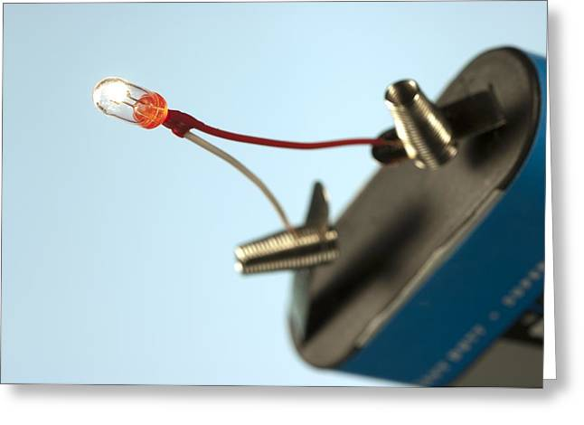 Miniature Light Bulb And Battery Greeting Card by Science Photo Library