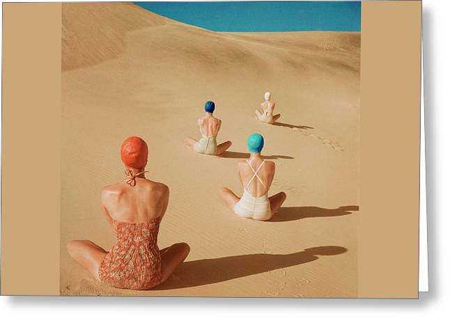 Models Sitting On Sand Dunes In California Greeting Card by Clifford Coffin