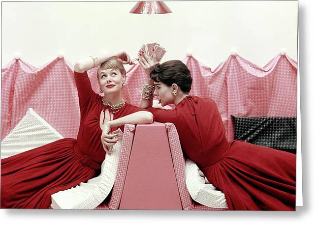 Models Wearing Red Dresses Greeting Card by Richard Rutledge