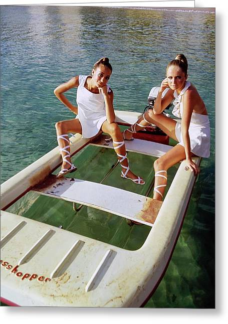 Models Wearing White Dresses On A Motorboat Greeting Card