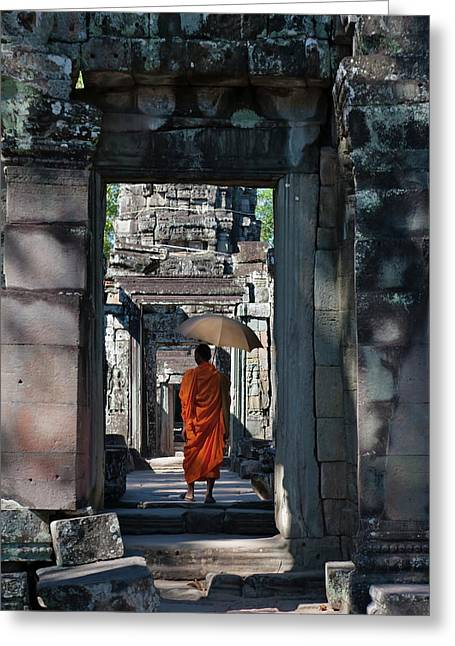 Monk With Buddhist Statues In Banteay Greeting Card by Keren Su