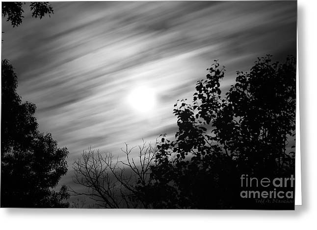 Greeting Card featuring the photograph Moonlit Clouds by Todd Blanchard