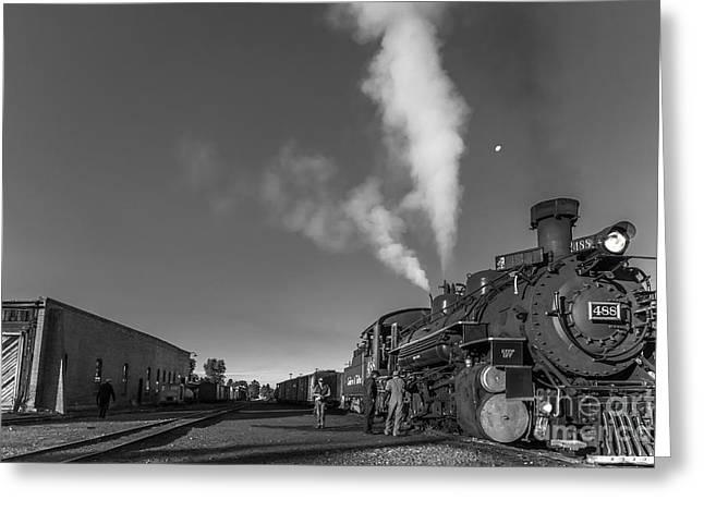 Distant Moon At Train Yard Greeting Card