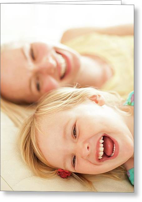 Mother And Her Daughter Laughing Greeting Card by Ian Hooton