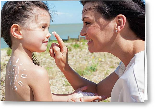 Mother Applying Suncream To Daughter Greeting Card