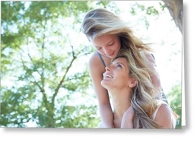 Mother Carrying Daughter Greeting Card