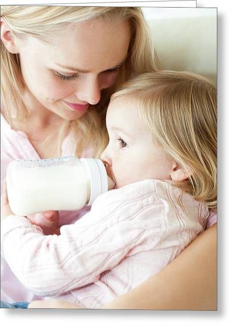 Mother Feeding Daughter With Bottle Greeting Card by Ian Hooton