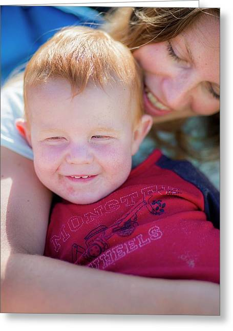 Mother Hugging Toddler With Red Hair Greeting Card by Samuel Ashfield