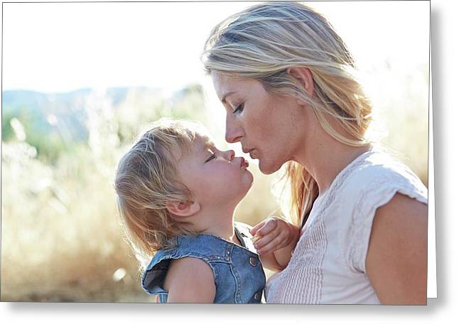 Mother Kissing Daughter Greeting Card