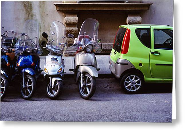 Motor Scooters With A Car Parked Greeting Card by Panoramic Images