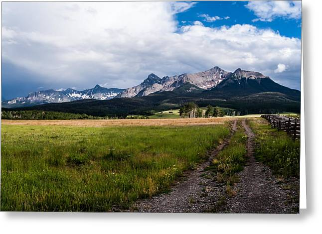 Greeting Card featuring the photograph Mountains And Fence by Jay Stockhaus