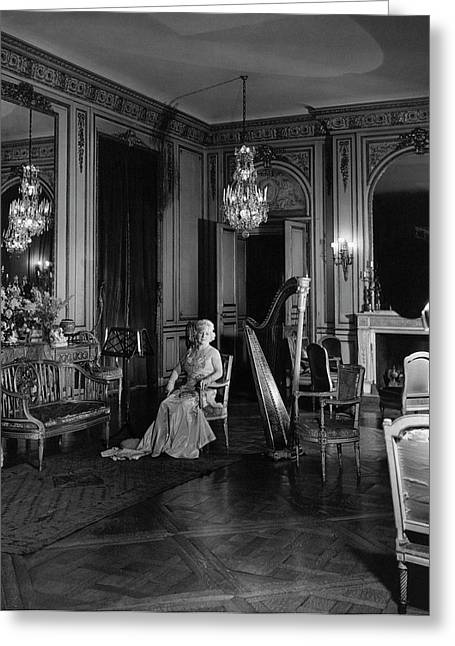 Mrs. Cornelius Sitting In A Lavish Music Room Greeting Card by Cecil Beaton