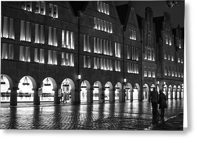 Cobblestone Night Walk In The Town Greeting Card by Miguel Winterpacht
