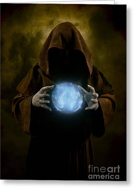 Mystery Man Wearing Cloak With Hood And Blue Glowing Crystal Ball Between His Hands Greeting Card by Jaroslaw Blaminsky