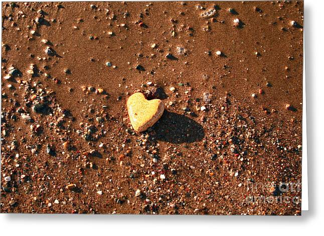Naturally Heart Shaped Stone On Sand Greeting Card by Leyla Ismet