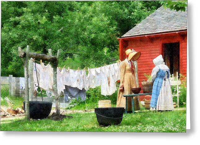 Neighbors Gossiping On Washday Greeting Card by Susan Savad