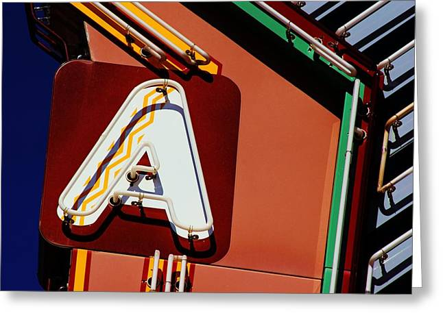 Greeting Card featuring the photograph Neon A - Aztec Theater by Daniel Woodrum