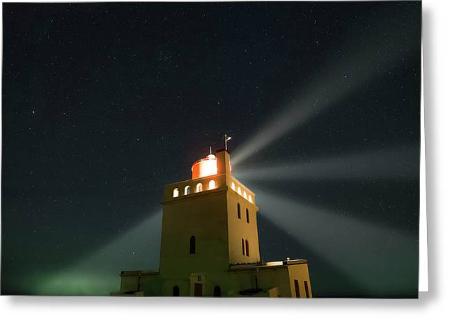 Night Sky Over A Lighthouse Greeting Card by Babak Tafreshi