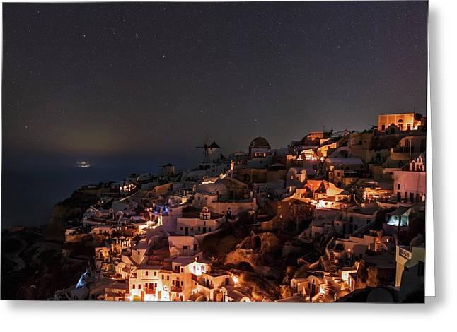 Night Sky Over Oia Greeting Card by Babak Tafreshi