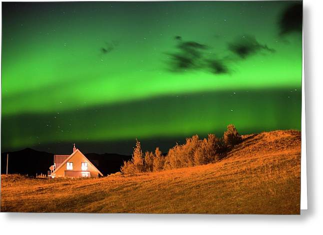 Northern Lights Over A House Greeting Card by Ashley Cooper