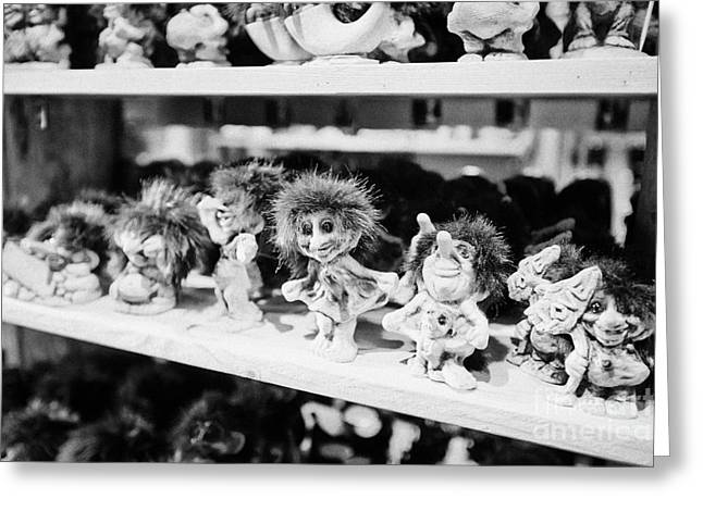 norwegian trolls souvenirs for sale in a gift shop Tromso troms Norway Greeting Card