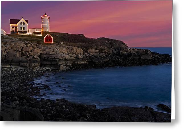 Nubble Lighthouse At Sunset Greeting Card by Susan Candelario