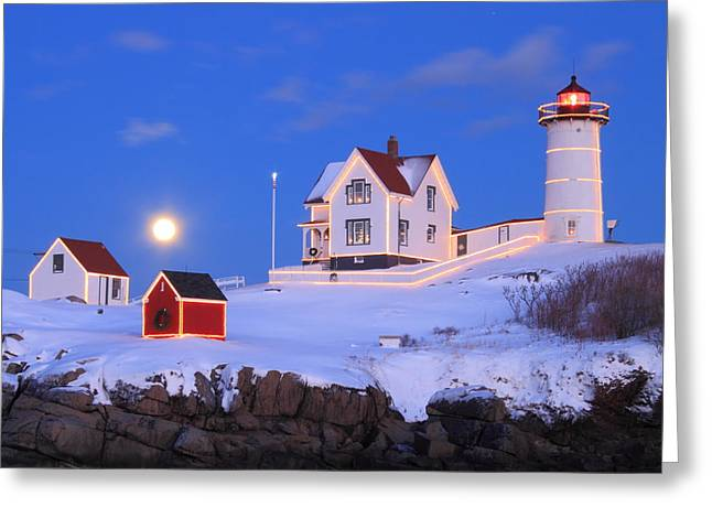 Nubble Lighthouse Full Moon And Holiday Lights Greeting Card by John Burk