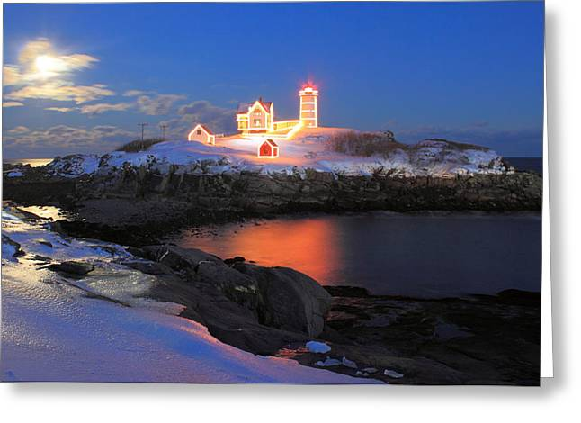 Nubble Lighthouse Holiday Lights And Winter Moon Greeting Card by John Burk