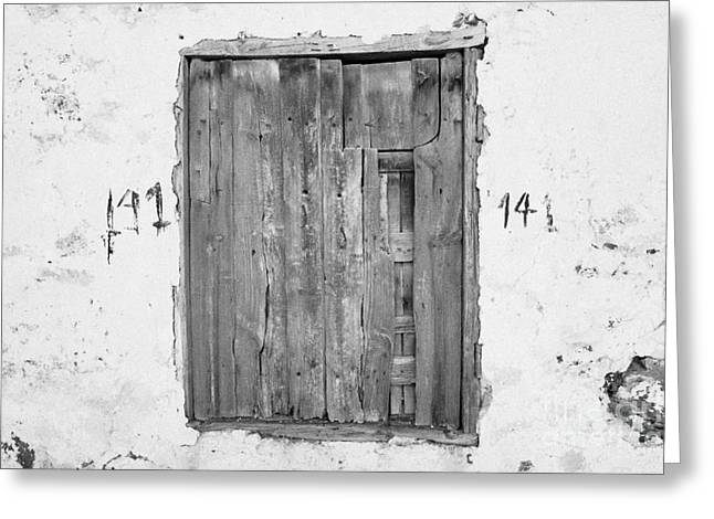 Number 141 Old Weathered Brown Wooden Window Shutters On Abandoned House With Cracked Stucco Yellow Walls In Tacoronte Tenerife Canary Islands Spain