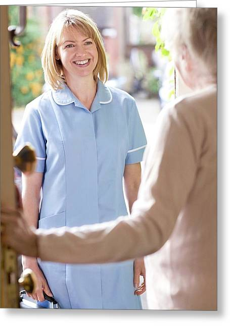 Nurse On A Home Visit Greeting Card by Science Photo Library