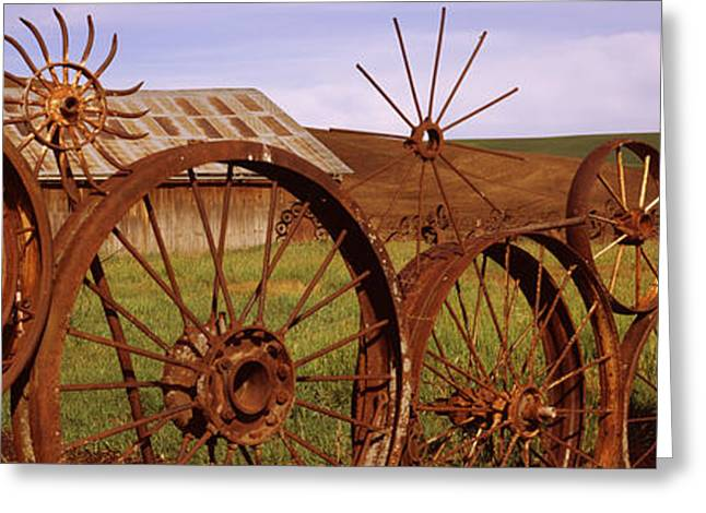 Old Barn With A Fence Made Of Wheels Greeting Card