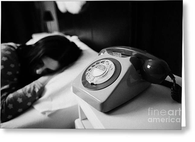 Old Fashioned Gpo Bt Phone On Bedside Table Of Early Twenties Woman In Bed In A Bedroom Greeting Card by Joe Fox